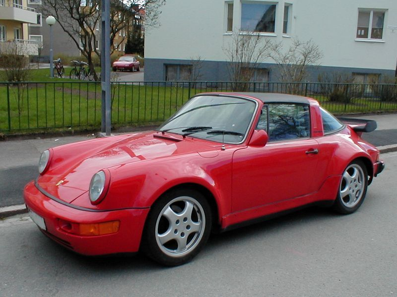 2097-a-red-porsche-parked-along-the-curb-pv